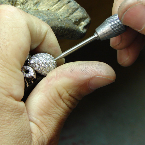 Jeweler setting diamonds