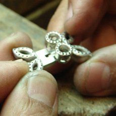 Jeweler trying clasp for necklace