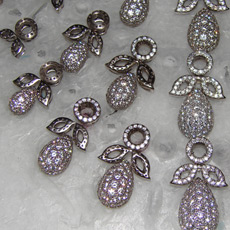 Finished pieces with pearls positioned on wax