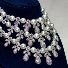 Finished diamond and pearl necklace on neck display