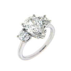 Pear shape diamond engagement ring with side stones