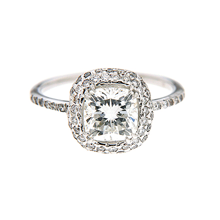 Cushion cut diamond engagement ring with halo