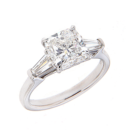 Cushion cut diamond engagement ring with trapezoid side stones