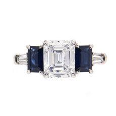 Emerald cut diamond three stone ring