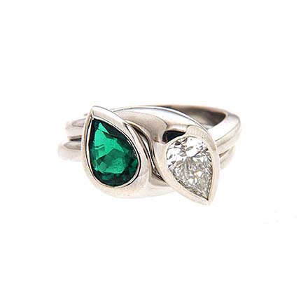 Two stone ring with emerald and diamond