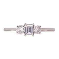 Emerald Cut and Round Diamond Ring